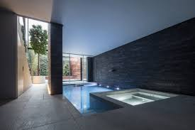 glass box defines extension with basement pool for victorian home