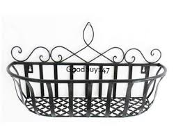 Wrought Iron Wall Planters by Wrought Iron Hanging Basket Zeckos Distressed Wooden Green Frame