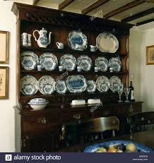blue and white china on oak dresser in cottage dining room stock
