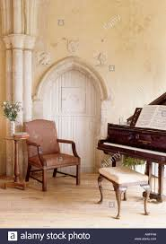 Gothic Living Room Grand Piano And Antique Chair Beside Gothic Door In Large Living