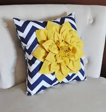 mellow yellow dahlia on navy and white zigzag pillow by bedbuggs