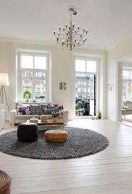 traditional living room with hardwood floors chandelier zillow