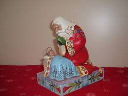 jim shore santa kneeling by baby jesus figurine the real meaning