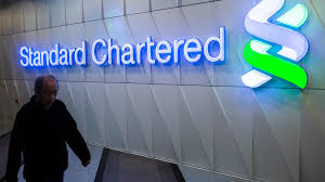 standard chartered losses narrow after cost cuts