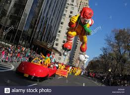 ronald mcdonald balloon on central park west during macy s stock