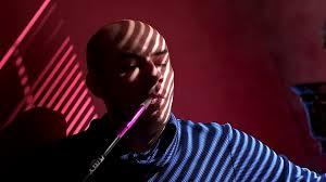 bald man shisha hookah at the window light through the blinds