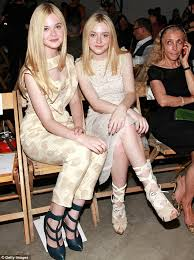 how old is dakota fanning new york fashion week 2011 elle fanning 13 towers over sister