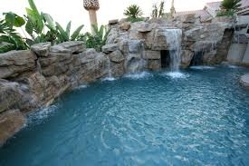 Lagoon Swimming Pool Designs by Rock Wall With Multiple Waterfalls In This Southern California