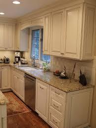 backsplash for cream cabinets cream kitchen cabinets with cocoa glaze nvg granite white subway