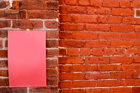 brick wall with an empty pink sign no cost royalty free stock