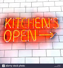 a bright red and yellow neon sign on s white tile wall stating