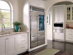 kitchen with stainless steel glass door refrigerator and white