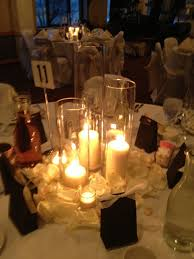 candle centerpieces wedding white and ivory candle wedding centerpieces devoted weddings and