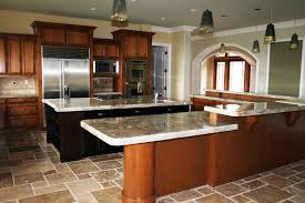 l shaped marble counter top brown stained wood kitchen cabinet