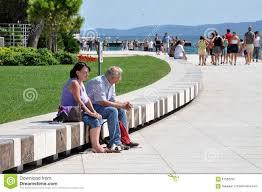 Sea Organ People Relaxing Near The Sea Organ Coast Of Zadar Croatia