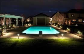 vibrant landscape lighting around pool outdoor swimming round designs