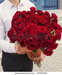 big bouquet of roses beautiful photo white shirt holding stock photo 248740465