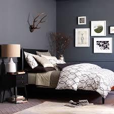 bedrooms mid century style bedroom with small black nightstand