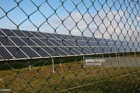 solar lights for chain link fence solar panels behind chain link fence stock photo getty images