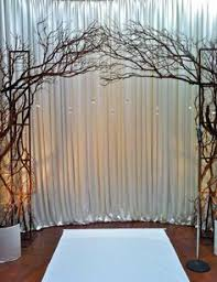 wedding arches made twigs draped sheer backdrop framed with twigs and flowers random swags