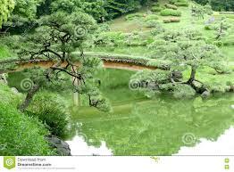 green hill bridge lake in japanese zen garden stock photo