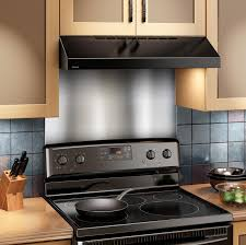 kitchen range hoods with brown wooden cabinet and gas stove