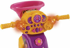 fisher price lights and sounds trike fisher price dora the explorer lights and sounds trike toyzonkers