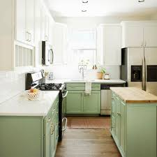 white kitchen cabinets with green countertops should i paint my cabinets two different colors paper