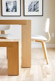 gus modern dining table a modern black blonde interior by calgary interior designer