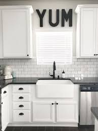 white kitchen cabinets with farm sink black white and teal kitchen farmhouse sink source