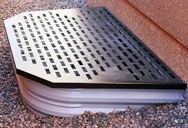 solution to bring light basement windows under a deckwindow well