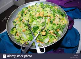a large bowl of caesar salad at a wedding buffet stock photo