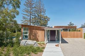 this wood clad and sloped roof modern house was designed for life