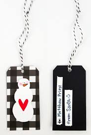 write white paper how to write on black paper with any pen a black and white black and white christmas gift tag jpriest