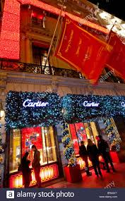 christmas lights and decorations outside the cartier store fifth