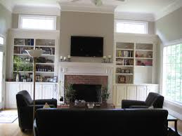 brown brick fireplace on the white wall combined with wall