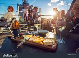 people eating cheese drinking wine rooftop stock photo 503787214