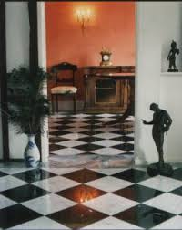 black and white marble flooring in foyer to the manor born