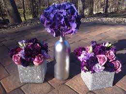 purple flowers centerpieces silver wine bottles purple