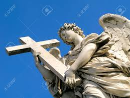 statue of an angel holding a cross outside of castel sant u0027angelo