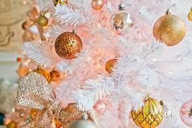 White Christmas Tree With Orange Decorations by California Winter Wonderland Glam Emily Henderson