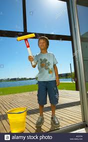the glass door a boy cleaning the glass door stock photo royalty free image