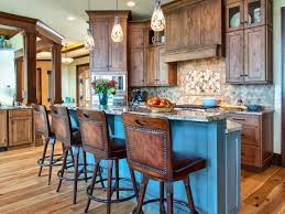 blue painted rustic kitchen island with wooden armless stools also