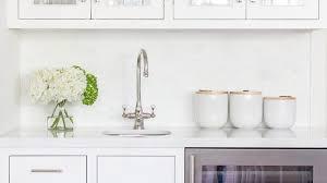 White Kitchen Brick Tiles - kitchen wet bar with white mini brick tiles transitional kitchen