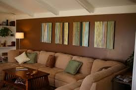 Light Brown Sofa by Dark Brown Walls With Outstanding Pictures In Living Room With
