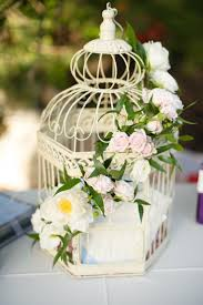 birdcages for wedding creative idea vintage birdcage with flowers arrangement and