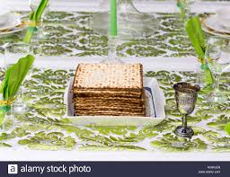 modern seder modern passover seder table with green and gold decorations in tel