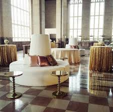 beautiful gold and white lounge and cocktail area for a wedding at