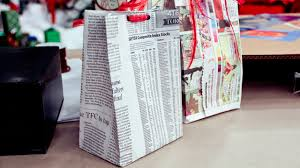 newspaper wrapping paper zero dollar wrapping steven and chris