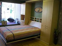 cream particle wood murphy bed with bookcase headboard and